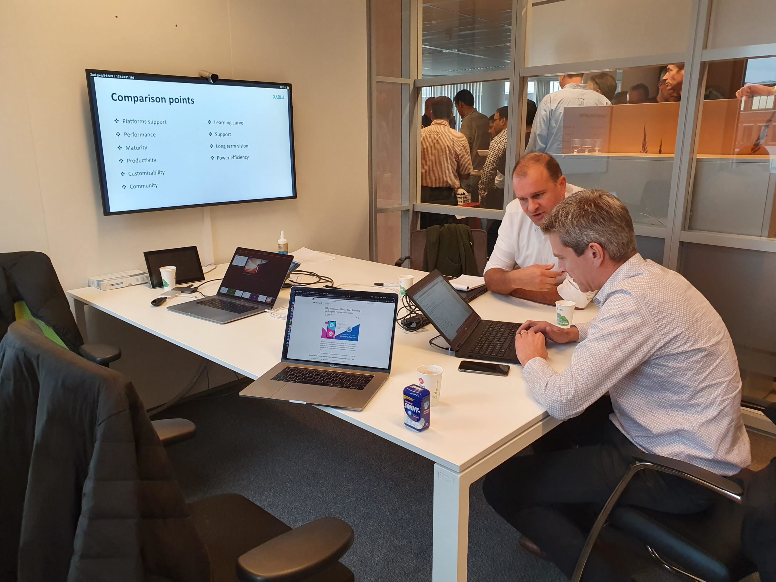 KPN looking at slides material for Mobiel Strategy Training